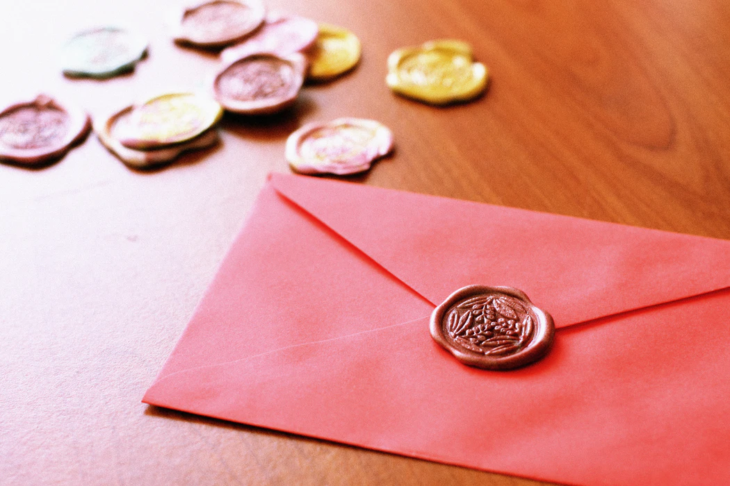 Envelope with decorative wax seal, artfully photographed