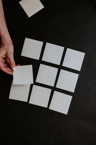 hand moving blank post-it cards